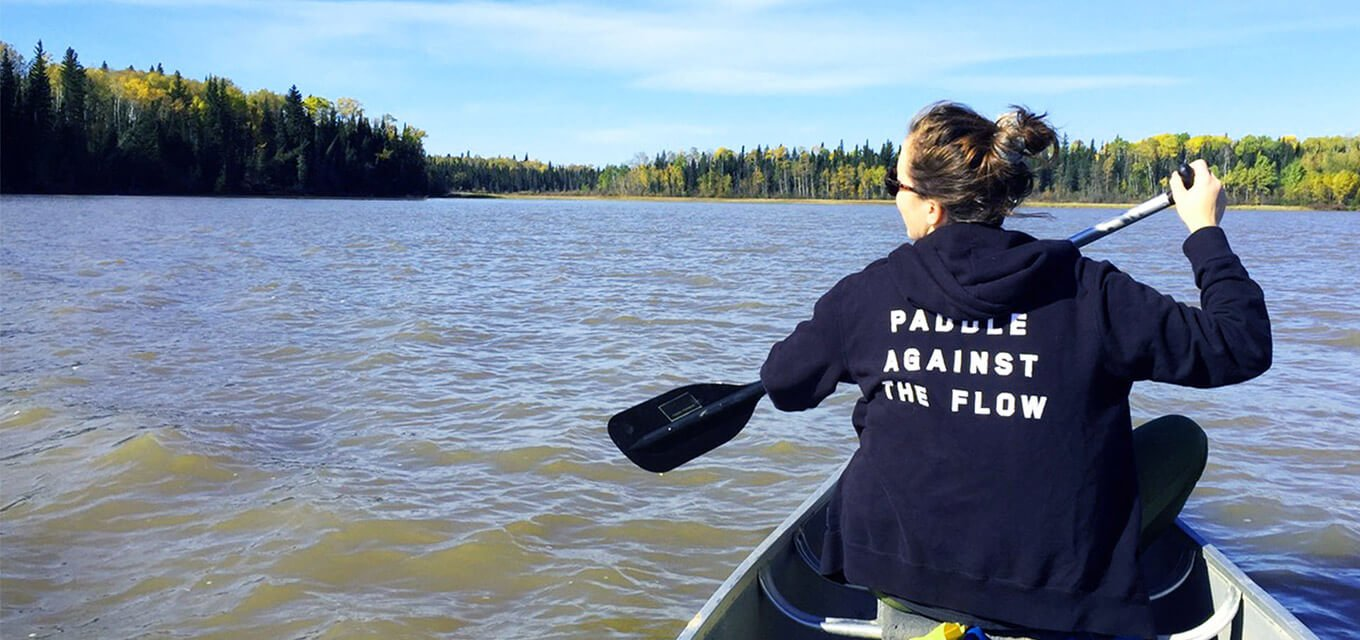 Canoeing on a lake while learning in the North