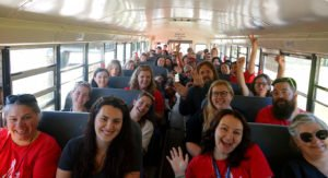 Teachers on a bus making connections at Summer Enrichment Program