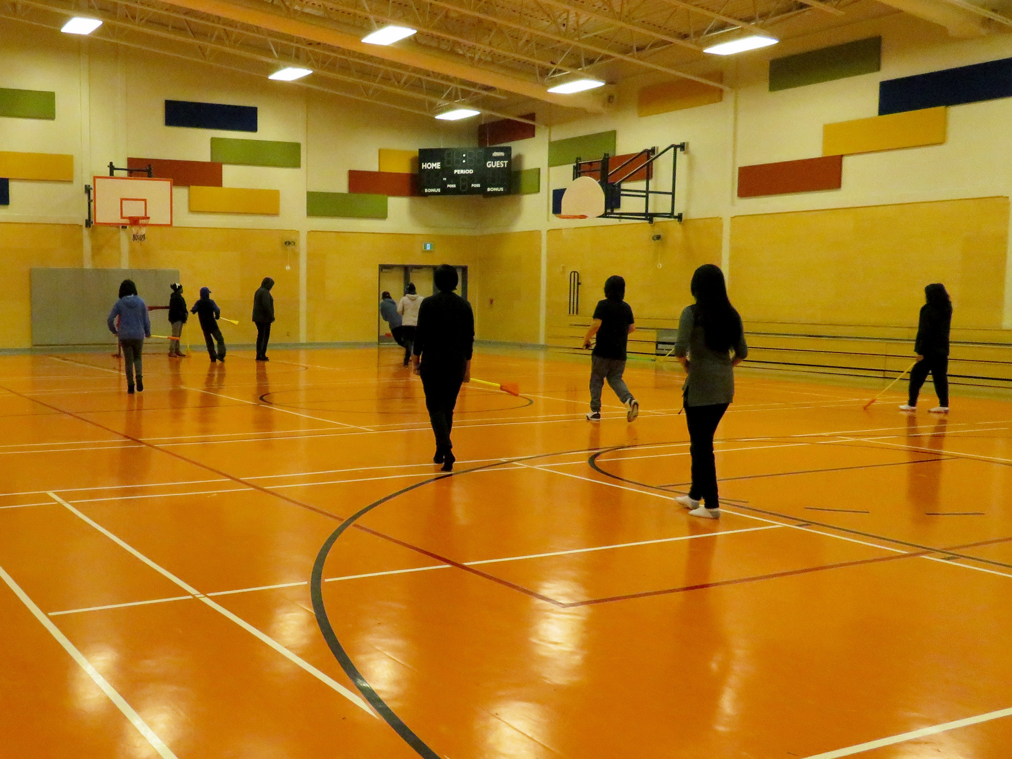 Kids playing broomball in Cat Lake First Nation