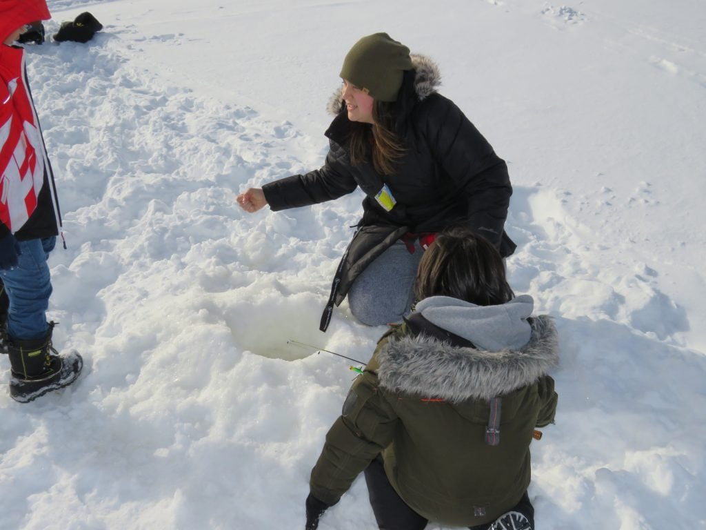 Emily goes ice fishing with her grade one students in Cat Lake First Nation