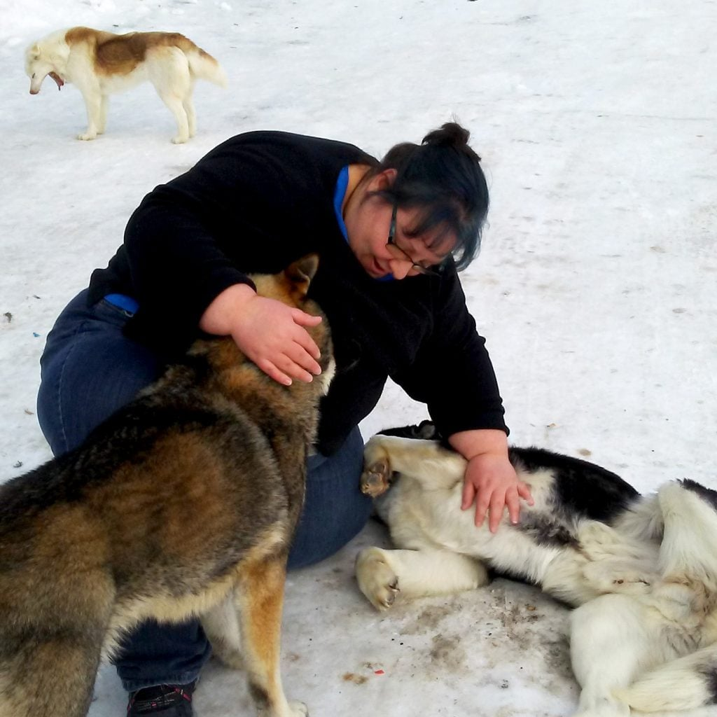 Teach For Canada teacher Kata gives dogs a belly rub