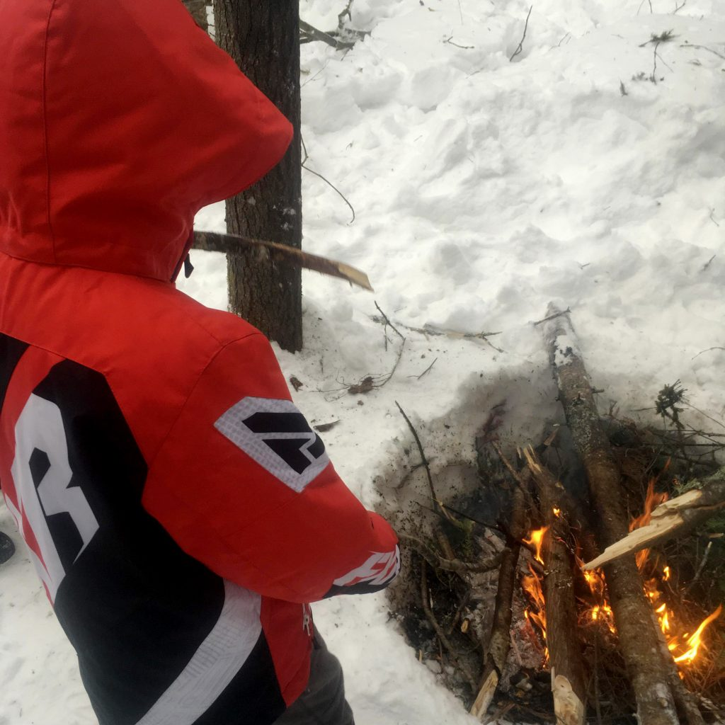 Students learn how to make a fire in Cat Lake First Nation