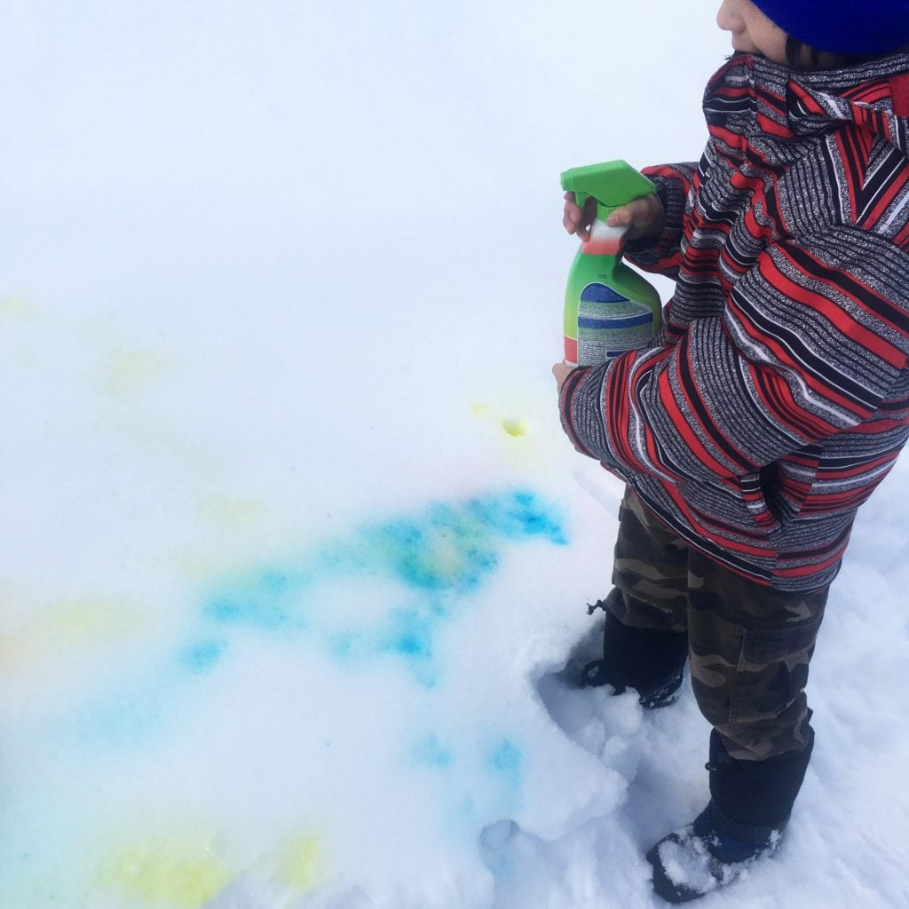 Grade 1 sudents learn about colour mixing outside in Cat Lake First Nation