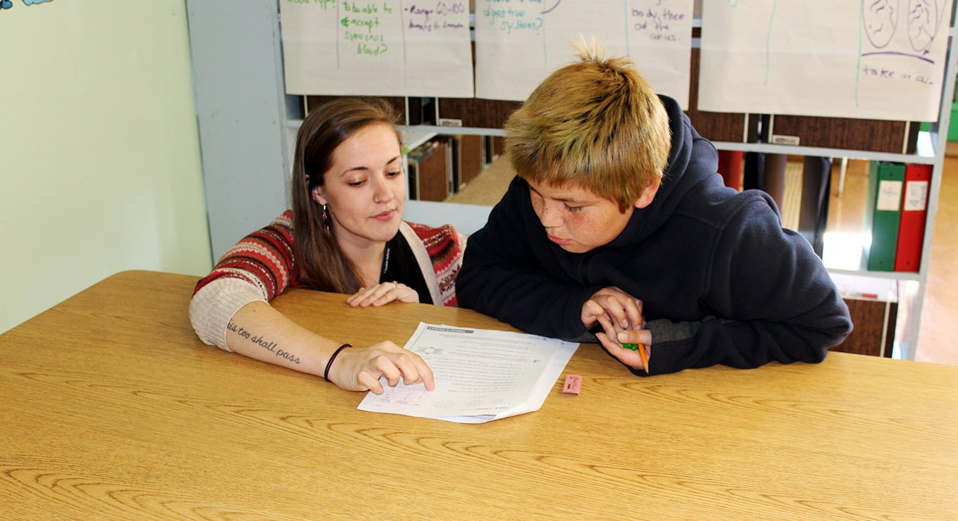 Teach For Canada Teacher working with a student