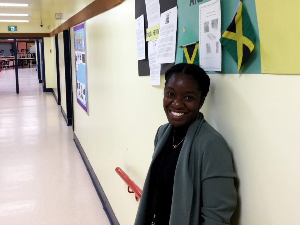 Teach For Canada Teacher Aissa Atkinson-Davis in the school hallway at John C. Yesno Education Centre