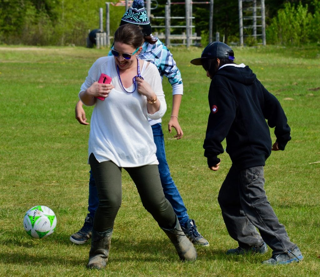 Teacher For Canada's Erica O'Reilly plays soccer with her students