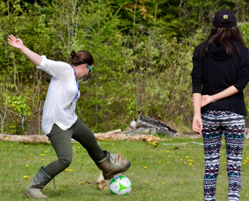 Erica and her students play soccer