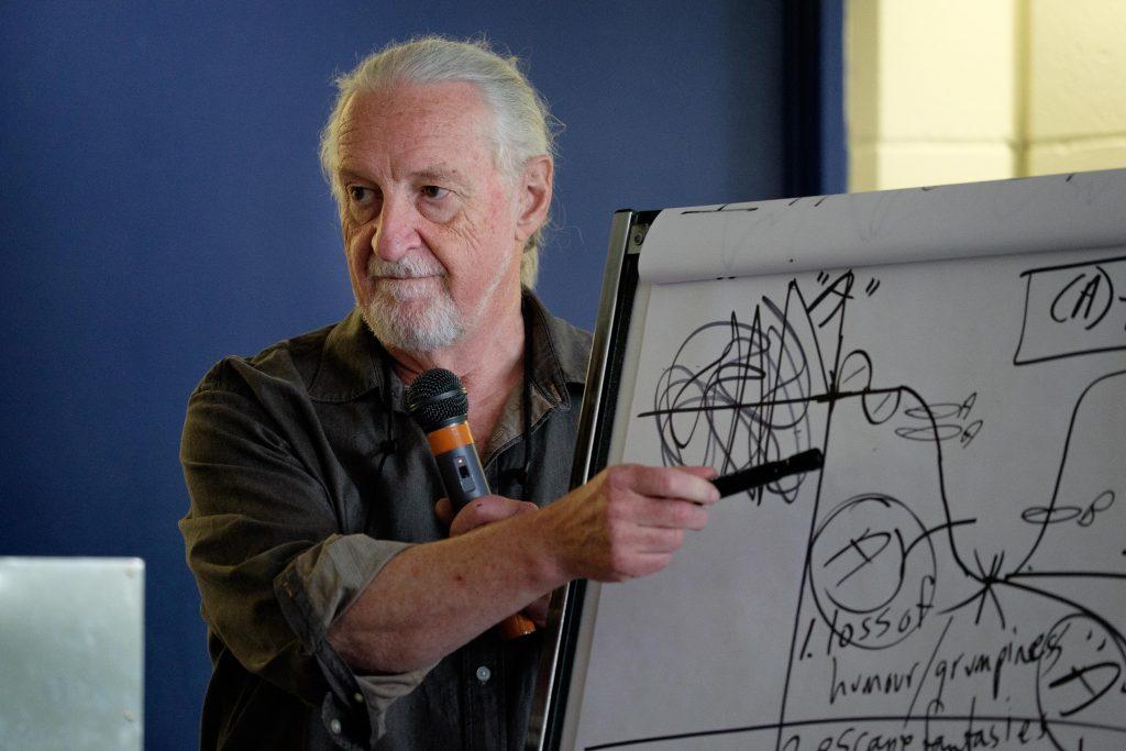 Randy Weekes pointing at a flip chart