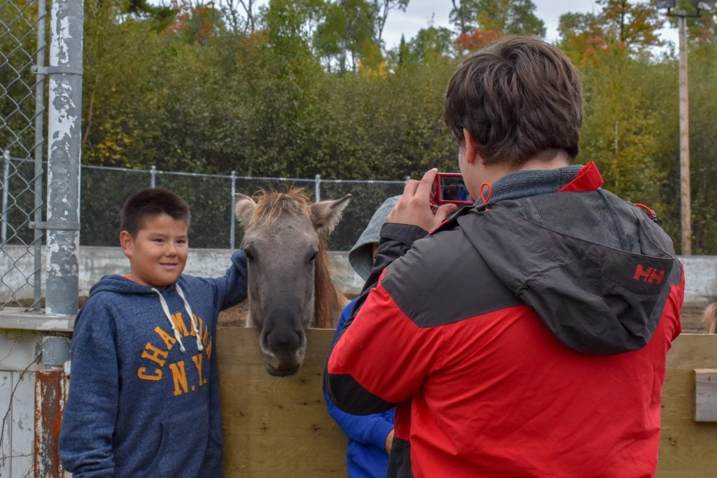 Nolan and his students take pictures with the Lac La Croix ponies