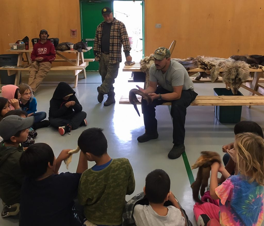 Trappers visit the school to teach trapping methods, safety, and animal skinning