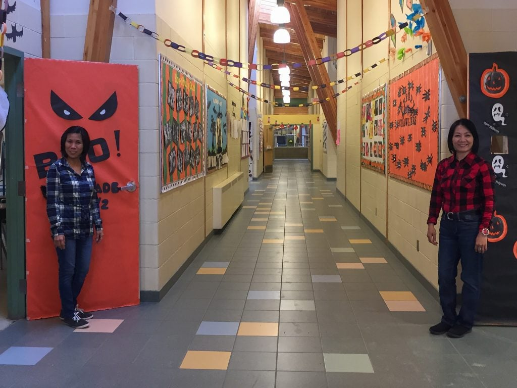 Doreen and Joyce in the hallway in Deer Lake School