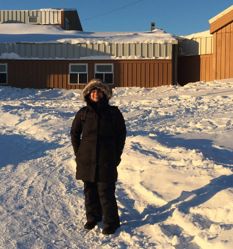 Jaya stands outside a building in Eabametoong First Nation
