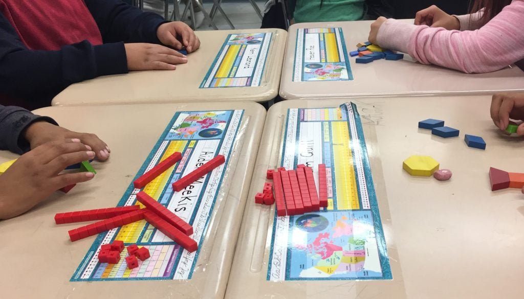 Jeevana's students work with math manipulatives