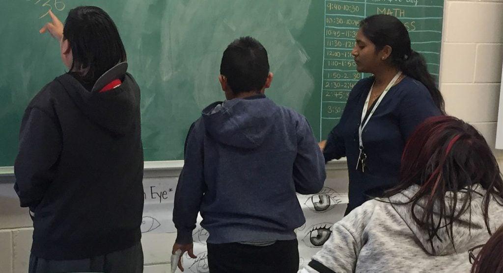 Jeevana Varakala teaching in Deer Lake