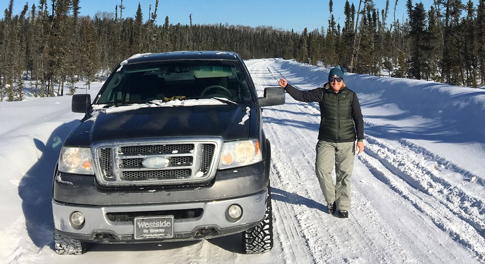 Deb Allen stands beside her truck on a snow covered road