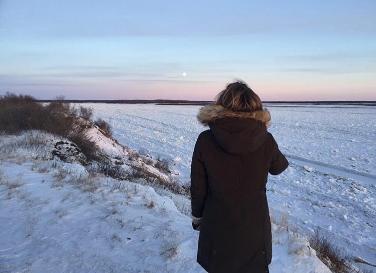 Kim looking out onto a frozen lake in Fort Severn First Nation