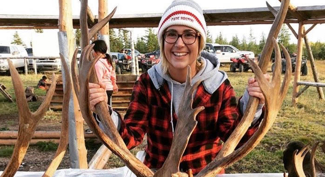 Teacher Kim holding caribou antlers